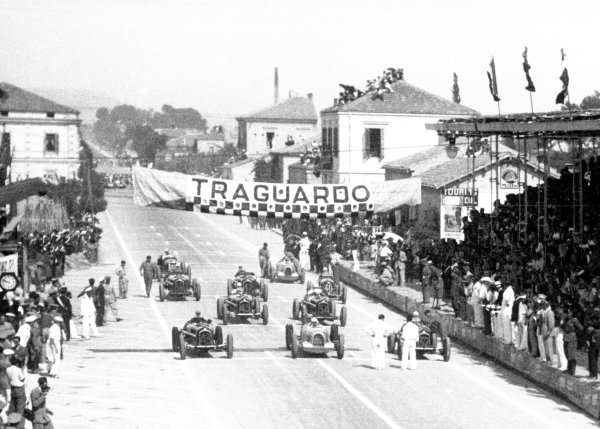 """1935 Coppa Acerbo Pescara, Italy. 15 August 1935 Moments before the start, front row from left-to-right: Tazio Nuvolari, Alfa Romeo Tipo-B """"P3"""", retired, Achille Varzi, Auto Union B, 1st position, and Louis Chiron, Alfa Romeo Tipo-B """"P3"""", 6th position, are followed by Antonio Brivio, Alfa Romeo Tipo-B """"P3"""", 3rd position, Mario Tadini, Alfa Romeo Tipo-B """"P3"""", 5th position, Piero Dusio, Maserati 8CM, retired, Carlo Maria Pintacuda, Alfa Romeo Tipo-B """"P3"""", retired, Gianfranco Comotti, Alfa Romeo Tipo-B """"P3"""", 4th position, Bernd Rosemeyer, Auto Union B, 2nd position, and Luigi Soffietti, Maserati 8CM, retired, action World Copyright: Robert Fellowes/LAT PhotographicRef: 35CA08"""