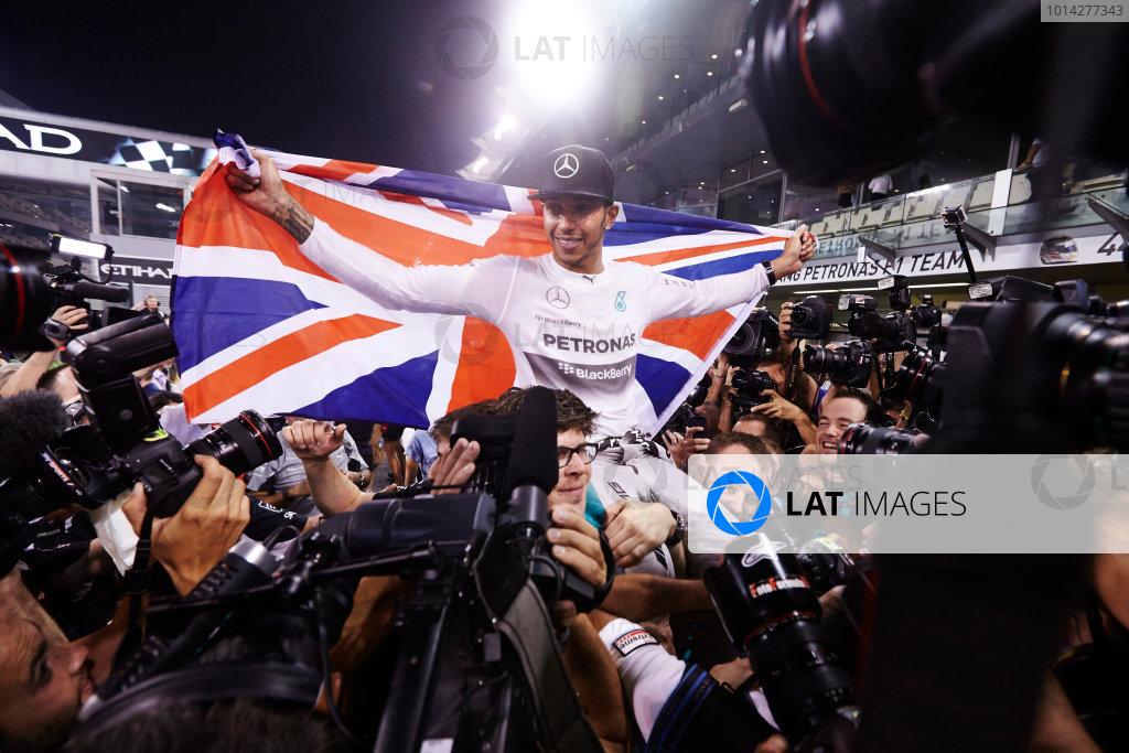 Yas Marina Circuit, Abu Dhabi, United Arab Emirates. Sunday 23 November 2014.  Lewis Hamilton, Mercedes AMG, celebrates championship victory.  World Copyright: Steve Etherington/LAT Photographic. ref: Digital Image SNE13423
