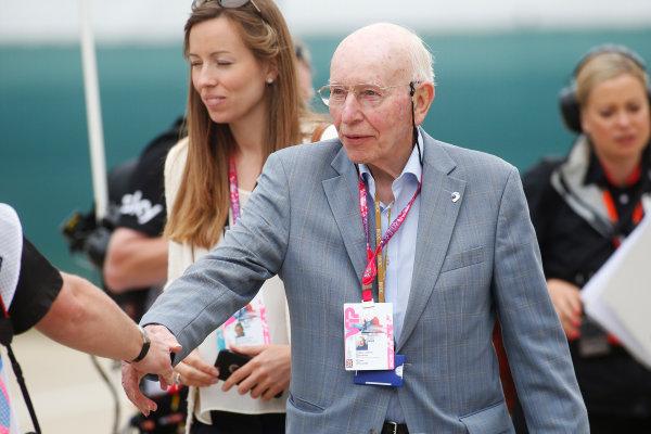 Silverstone Circuit, Northamptonshire, England. Sunday 5 July 2015. John Surtees greets a member of the media. World Copyright: Andrew Ferraro/LAT Photographic ref: Digital Image _FER9137