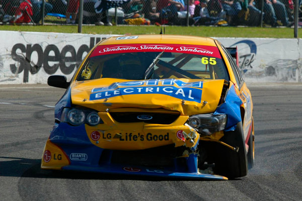 2003 Australian V8 SupercarsOran Park, Sydney, Australia. 17th August 2003.Ford driver Paul Radisich retires after being hit by Rick Kelly on the first lap of todays 300km race at Sydneys Oran Park. World Copyright: Mark Horsburgh/LAT Photographicref: Digital Image Only