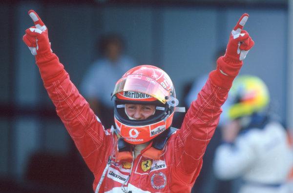 2004 Japanese Grand Prix.Suzuka , Japan 8th - 10th October 2004Michael Schumacher, Ferrari F2004 celebrates his victory.World Copyright:Peter Spinney/LAT Photographic ref: 35mm Image: A21