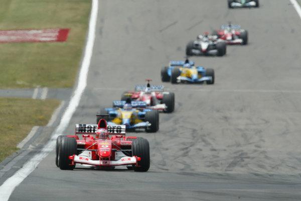 2003 European Grand Prix - Sunday RaceNurburgring, Germany.29th June 2003.Rubens Barrichello, Ferrari F2003 GA leads Fernando Alonso, Renault R23, action.World Copyright LAT Photographic.Digital Image Only.