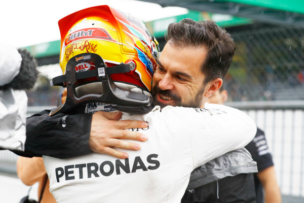 Autodromo Nazionale di Monza, Italy. Saturday 02 September 2017. Lewis Hamilton, Mercedes AMG, celebrates with Marc Hynes after taking his 69th F1 Pole Position. World Copyright: Steven Tee/LAT Images  ref: Digital Image _O3I6439