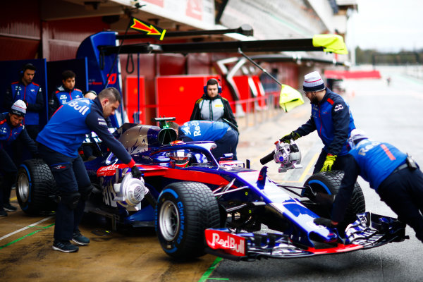 Circuit de Catalunya, Barcelona, Spain. Wednesday 28 February 2018. Brendon Hartley, Toro Rosso STR13 Honda, is wheeled back into his pit garage by mechanics. World Copyright: Andy Hone/LAT Images ref: Digital Image _ONY9863