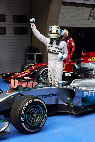 Shanghai International Circuit, Shanghai, China. Sunday 20 April 2014. Lewis Hamilton, Mercedes AMG, 1st Position, celebrates on arrival in Parc Ferme. World Copyright: Steve Etherington/LAT Photographic. ref: Digital Image SNE20780 copy