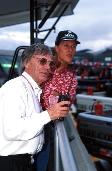 Winner Michael Schumacher(GER) Benetton B195 and F1 Supremo Bernie Ecclestone. Brazilian Grand Prix, Interlagos - 26th March 1995