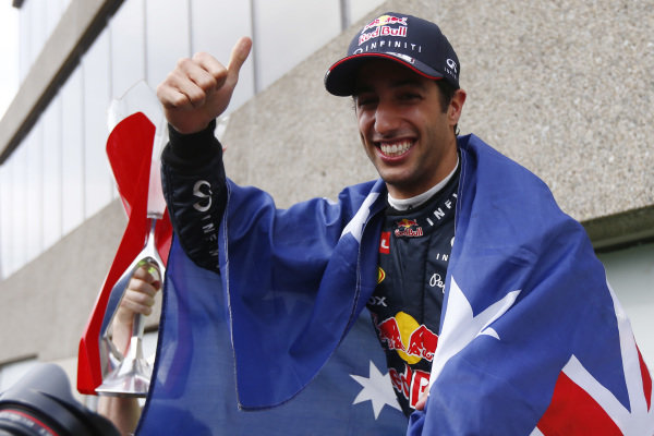 Circuit Gilles Villeneuve, Montreal, Canada. Sunday 8 June 2014. Daniel Ricciardo, Red Bull Racing, 1st Position, celebrates his maiden win with his team. World Copyright: Andy Hone/LAT Photographic. ref: Digital Image _ONZ3763