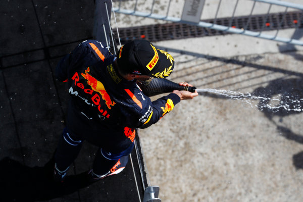 Circuit Gilles Villeneuve, Montreal, Canada. Sunday 11 June 2017. Daniel Ricciardo, Red Bull Racing, celebrates third place by spraying champagne on the podium. World Copyright: Steven Tee/LAT Images ref: Digital Image _O3I0146