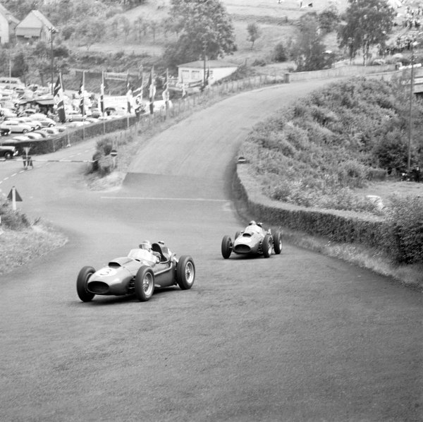 Nurburgring, Germany. 1-3 August 1958.Mike Hawthorn leads Peter Collins (both Ferrari Dino 246's) on lap 4. Collins passed his team-mate but would later suffer a fatal accident while leading. Ref-2272.World Copyright - LAT Photographic
