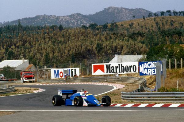 Estoril, Portugal. 18 - 20 September 1987.Alex Caffi (Osella FA1L-Alfa Romeo), retired, action. World Copyright: LAT Photographic.Ref:  87POR30.
