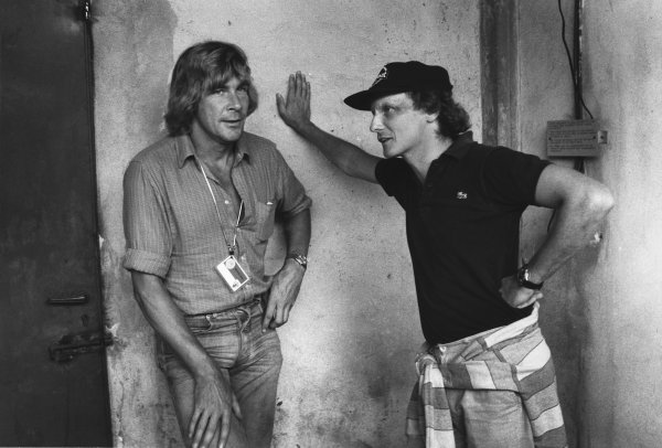 Monza, Italy. 11th - 13th September 1981. Niki Lauda and James Hunt, both retired from racing, in conversation in the paddock, portrait.  World Copyright: LAT Photographic.  Ref:  B/W Print.