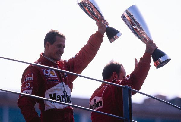 2002 Italian Grand PrixMonza, Italy. 14th - 16th September 2002Michael Schumacher, Ferrari F2002, and Rubens Barrichello, Ferrari F2002 on the podiumWorld Copyright - LAT Photographicref: 35mm Transparency 02_ITA_37