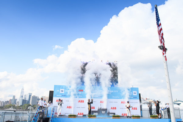 Maximilian Guenther (DEU), BMW I Andretti Motorsport, 1st position, Jean-Eric Vergne (FRA), DS Techeetah, 2nd position, and Lucas Di Grassi (BRA), Audi Sport ABT Schaeffler, 3rd position, celebrate with CHampagne on the podium