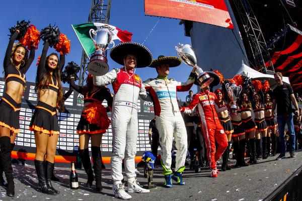 Winner Benito Guerra (MEX) celebrates on the podium with runner up Loic Duval (FRA) and ROC Skills Challenge winner Sebastian Vettel (GER)