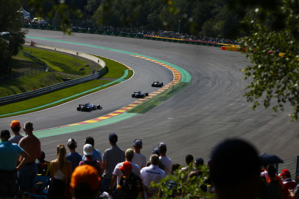 Kevin Magnussen, Haas VF-19, leads Valtteri Bottas, Mercedes AMG W10, and Lewis Hamilton, Mercedes AMG F1 W10