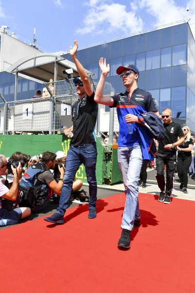 Robert Kubica, Williams Racing, and Daniil Kvyat, Toro Rosso, in the drivers parade