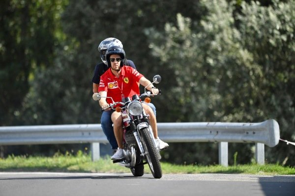Sebastian Vettel, Ferrari, on his motorcycle