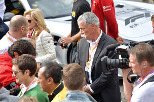 Chase Carey, Chairman, Formula 1, stand on the grid for the memorial of Anthoine Hubert (FRA, BWT ARDEN)