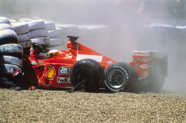 Michael Schumacher, Ferrari F399, crashes out at Stowe. The German driver broke his leg in the accident which would sideline him until the penultimate round.