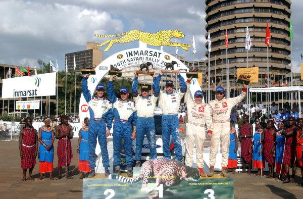 2002 World Rally Championship.Safari Rally, Nairobi Kenya, July 11-14th.The top three crews with their trophies.Photo: Ralph Hardwick/LAT