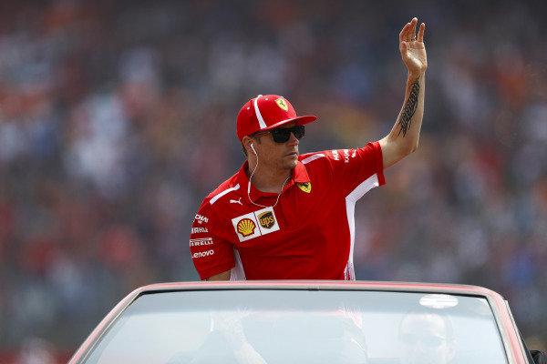 Kimi Raikkonen, Ferrari,  waves to fans from a Ferrari Mondial on the drivers' parade.