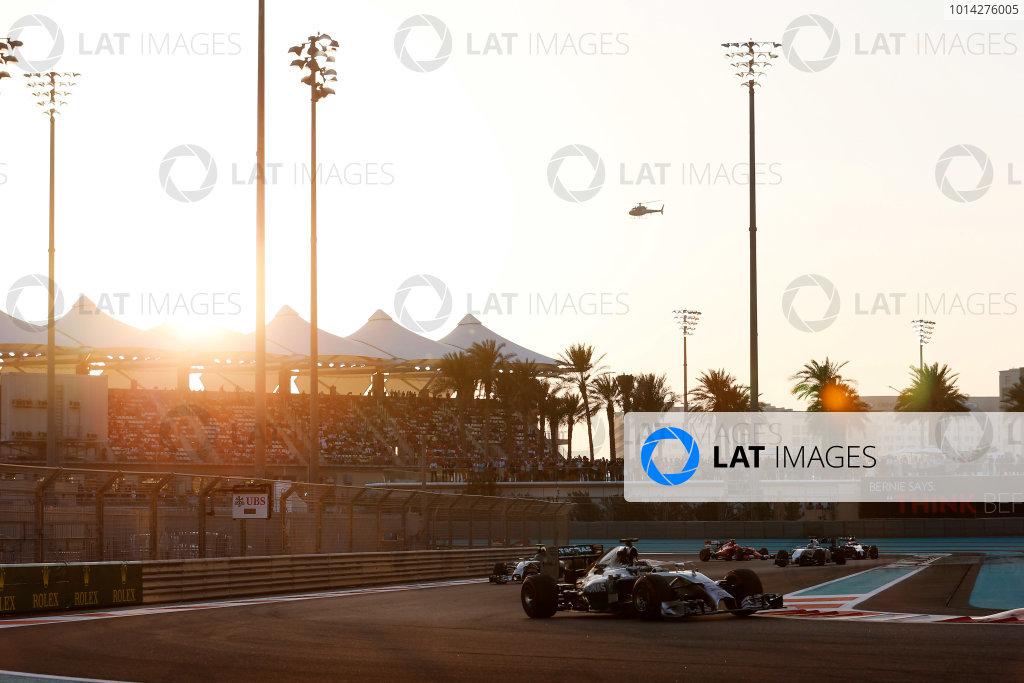 Yas Marina Circuit, Abu Dhabi, United Arab Emirates. Sunday 23 November 2014. Lewis Hamilton, Mercedes F1 W05 Hybrid, leads Nico Rosberg, Mercedes F1 W05 Hybrid, and Felipe Massa, Williams FW36 Mercedes. World Copyright: Steven Tee/LAT Photographic. ref: Digital Image _L4R7085