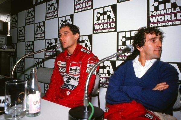 L-R: Newly crowned 1988 F1 World Champion Ayrton Senna (BRA) gives a post race interview alongside McLaren team mate Alain Prost (FRA). Japanese Grand Prix, Rd15, Suzuka, Japan. 30 October 1988.