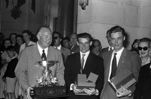 1956 Le Mans 24 Hours. Le Mans, France. 28-29 July 1956. Ninian Sanderson/Ron Flockhart (Jaguar), 1st position. Saunderson and Flockhart receive their winners trophy. World Copyright - LAT Photographic.