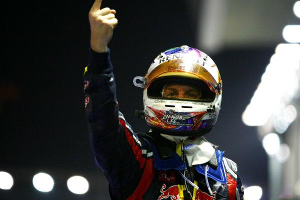 Marina Bay Circuit, Singapore.25th September 2011.Sebastian Vettel, Red Bull Racing RB7 Renault, 1st position, celebrates victory in Parc Ferme. Portrait. Helmets. Finish. World Copyright: Andy Hone/LAT Photographicref: Digital Image CSP28769