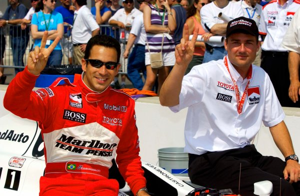 Week one of practice for the 87th Indianapolis 500, Indianapolis Motor Speedway, Speedway, Indiana, USA 25 May,2003 Helio Castroneves and Team Penske manager Tim Cindric hold up two fingers for their back-to-back wins in the 500.