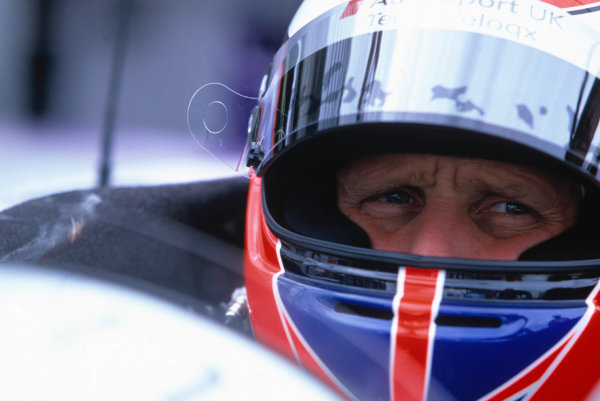 2004 Le Mans Endurance SeriesSilverstone 1000 KilometersSilverstone, England. 12th - 14th August 2004Third placed Johnny Herbert (Veloqx Audi R8) peers out from his crash helmet. Portrait.World Copyright: Glenn Dunbar/LAT Photographicref: 35mm Transparency A16