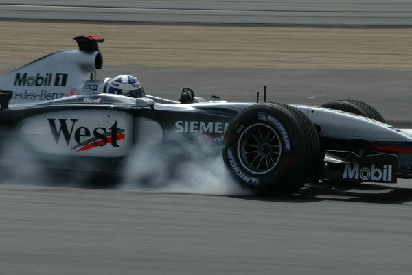 2003 European Grand Prix - Friday 1st Qualifying,Nurburgring, Germany. 27th June 2003 David Coulthard, Team McLaren Mercedes MP4-17D, locks up under braking.World Copyright: Steve Etherington/LAT Photographic ref: Digital Image Only