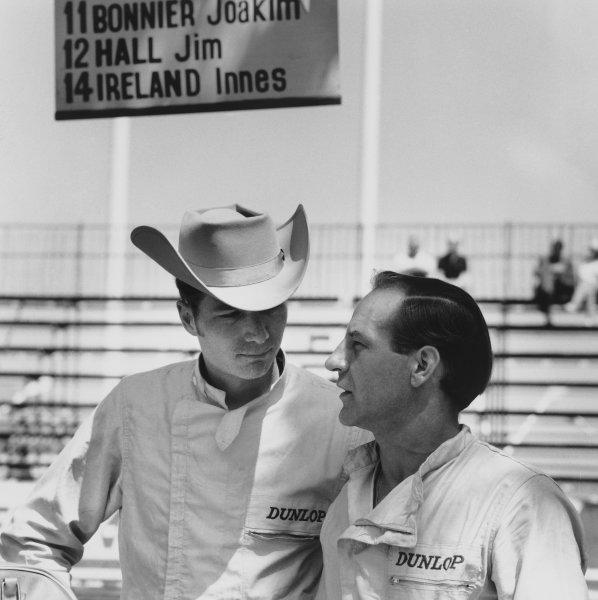 Monte Carlo, Monaco. 23 - 26 May 1963.Innes Ireland (Lotus 24-BRM), retired, talks to team mate Jim Hall (Lotus 24-BRM), retired, portrait. World Copyright: LAT Photographic.Ref:  19671.