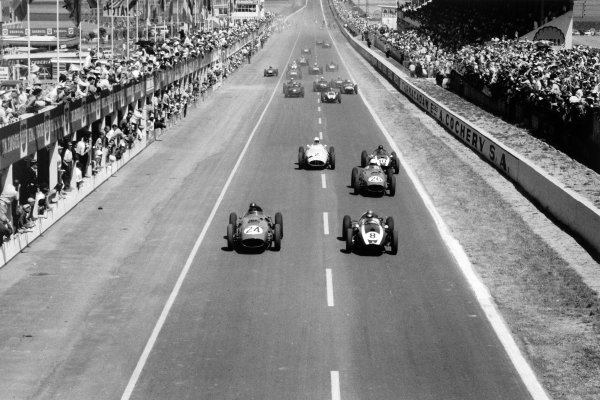 1959 French Grand Prix Reims, France. 5 July 1959 Tony Brooks, #24 Ferrari Dino 246, 1st position, and Jack Brabham, Cooper T51-Climax, 3rd position, lead at the start. Phil Hill, Ferrari Dino 246, 2nd position, Masten Gregory, Cooper T51-Climax, retired, Stirling Moss, BRM P25, retired, Bruce McLaren, Cooper T45-Climax, 5th position, Harry Schell, BRM P25, 7th position, and Ron Flockhart, BRM P25, 6th position, follow, action World Copyright: LAT PhotographicRef: Autosport b&w print. Published: Autosport, 10/7/1959 p46