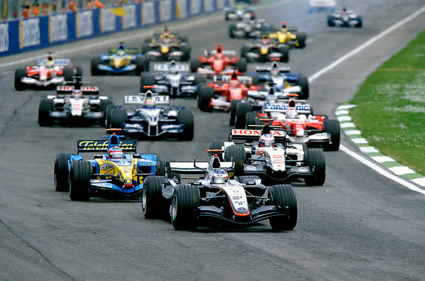 2005 San Marino Grand Prix.Imola, Italy. 24th April 2005.Kimi Raikkonen, McLaren Mercedes MP4-20 leads the field away from the start line. Action. World Copyright: Steven Tee/LAT Photographic Ref: 35mm Image A02