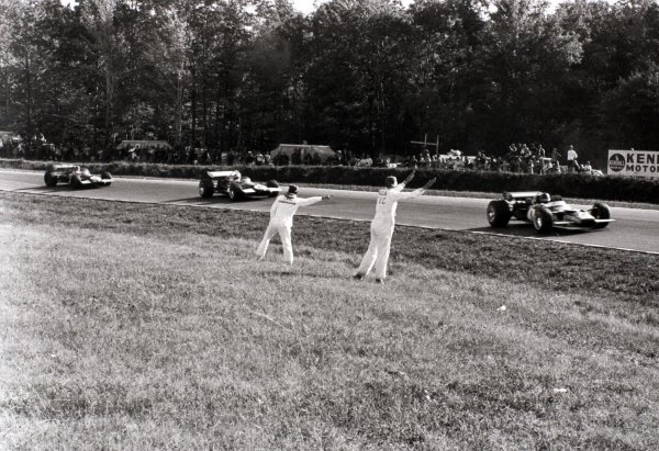 1969 United States Grand Prix Watkins Glen, United States. 5 October 1969 Graham Hill, Lotus 49B-Ford, retired, leads Piers Courage, Brabham BT26-Ford, 2nd position, and Jack Brabham, Brabham BT26-Ford, 4th position, action World Copyright: LAT PhotographicRef: b&w print
