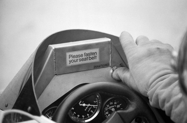 Emerson Fittipaldi (BRA) Fittipaldi F8, who retired from the race on lap 19 with a broken skirt, has a message above his steering wheel reminding him to fasten his seat belt.Formula One World Championship, German Grand Prix, Rd9, Hockenheim, 10 August 1980.