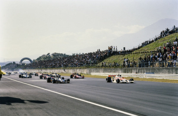 James Hunt, McLaren M26 Ford takes the lead from pole sitter Mario Andretti, Lotus 78 Ford at the start.