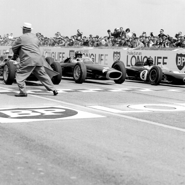 1963 French Grand Prix Reims, France 28-30 June 1963.(L-R) Jim Clark (Lotus 25 Climax/behind the starter) on pole, with Graham Hill (BRM P61) 2nd and Dan Gurney (Brabham BT7 Climax) 3rd position, on the front row of the grid for the start Ref-20111B/W World Copyright - LAT Photographic