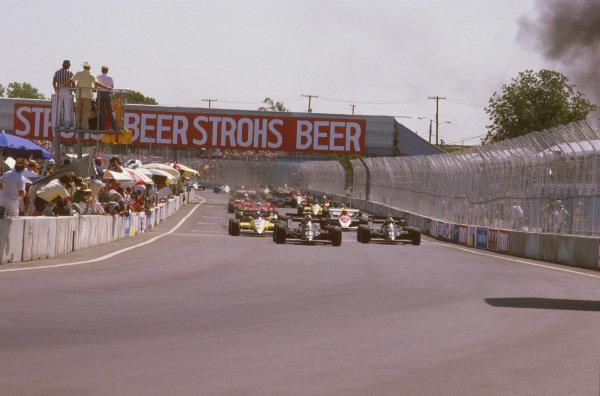 Fair Park, Dallas, Texas, USA.6-8 July 1984.Nigel Mansell leads Elio de Angelis (both Lotus 95T Renault's) and Derek Warwick (Renault RE50) at the start.Ref-84 DAL 12.World Copyright - LAT Photographic
