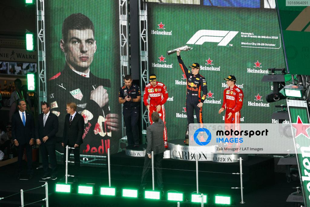 Sebastian Vettel, Ferrari, 2nd position, Max Verstappen, Red Bull Racing, 1st position, and Kimi Raikkonen, Ferrari, 3rd position, on the podium