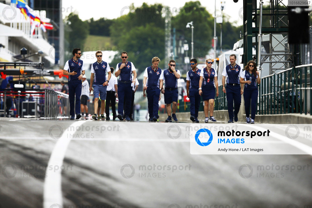 Sergey Sirotkin, Williams FW41 Mercedes, walks the track with his team.