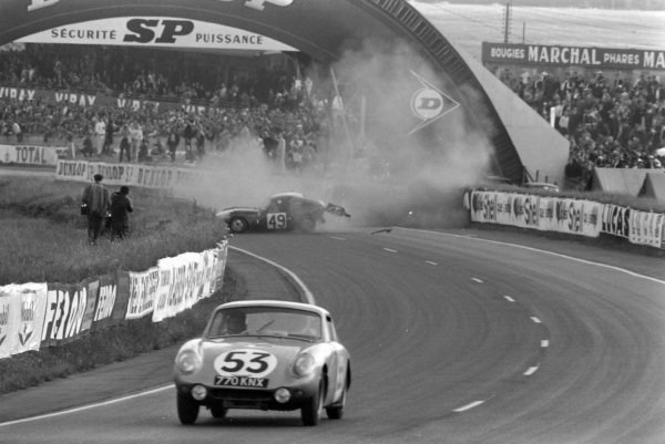 Bill Bradley / Clive Baker, Healey Motors, Austin Healey Sprite, passes as Mike Rothschild / Bob Tullius, Standard Triumph International, Triumph Spitfire, crashes out in the background.