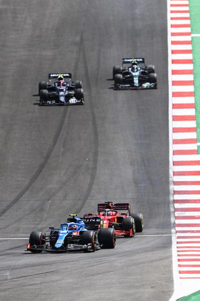 Esteban Ocon, Alpine A521, leads Charles Leclerc, Ferrari SF21, Pierre Gasly, AlphaTauri AT02, and Sebastian Vettel, Aston Martin AMR21