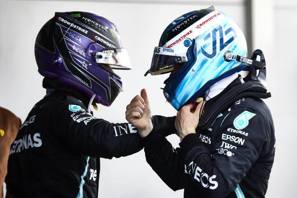 Sir Lewis Hamilton, Mercedes, 1st position, and Valtteri Bottas, Mercedes, 3rd position, congratulate each other in Parc Ferme