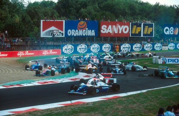 1994 Italian Grand Prix.Monza, Italy.9-11 September 1994.Johnny Herbert (Lotus 109 Mugen-Honda) is spun round at the Rettifilo Chicane at the start by Eddie Irvine (Jordan 194 Hart) because he could not brake as quickly as him so ended up hitting him from behind. Everybody else takes avoiding action in the melee.Ref-94 ITA 07.World Copyright - LAT Photographic