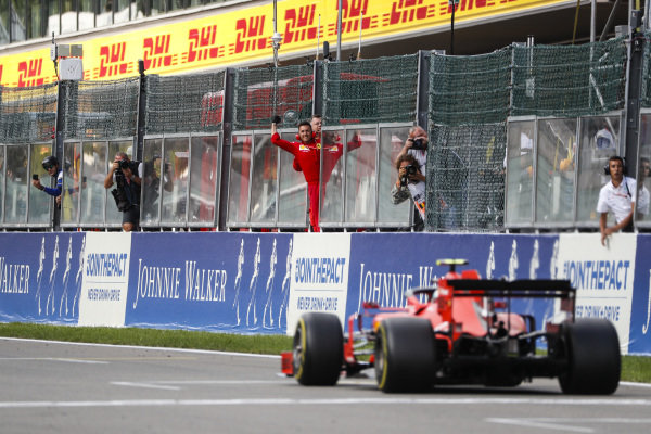 Charles Leclerc, Ferrari SF90, is congratulated at the finish by his team