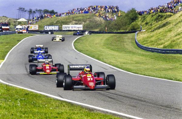 Michele Alboreto, Ferrari 156/85, leads Stefan Johansson, Ferrari 156/85, Jacques Laffite, Ligier JS25 Renault, and Stefan Bellof, Tyrrell 014 Renault.