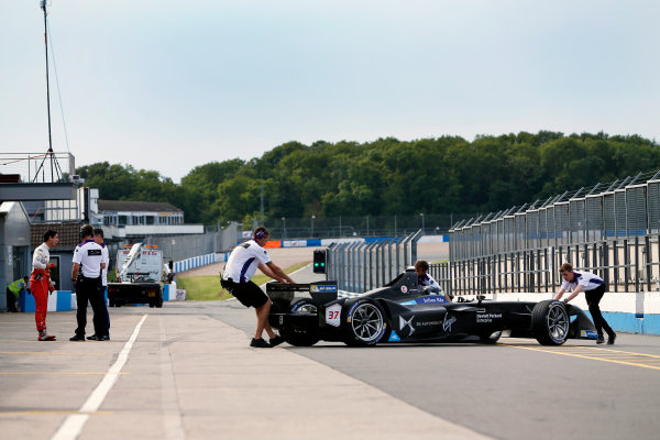 FIA Formula E Season 3 Testing - Day Two. Donington Park Racecourse, Derby, United Kingdom. Jose Maria Lopez, DS Virgin Racing, Spark-Citroen, is pushed back to his garage in the pit lane. Lucas di Grassi shares a joke on the left of the picture. Wednesday 24 August 2016. Photo: Adam Warner / LAT / FE. ref: Digital Image _L5R0770