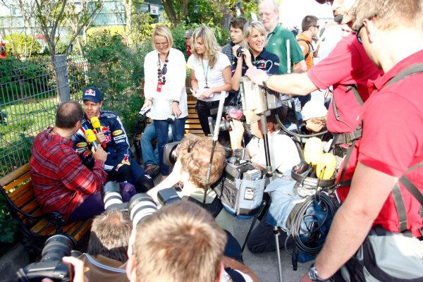 Shanghai International Circuit, Shanghai, China18th April 2009Sebastian Vettel, Red Bull Racing RB5 Renault, is interviewed. Portrait. Media. World Copyright: Charles Coates/LAT Photographicref: Digital Image _26Y4073